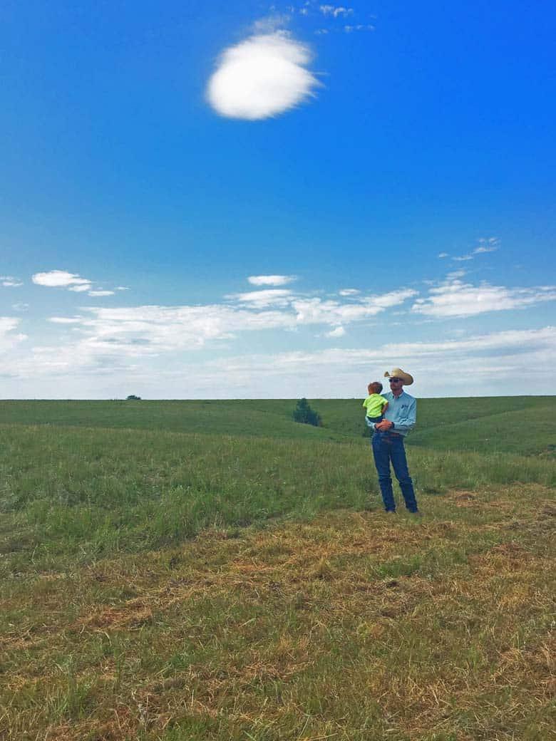 Cowboy and his son on the ranch, Wichita Kansas.