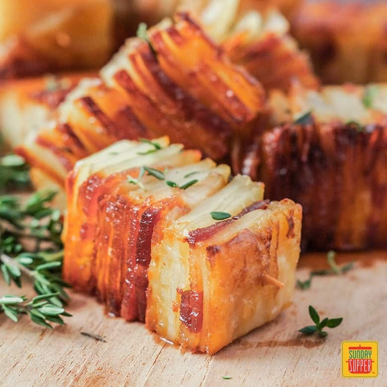 Potato Pave with Bacon and Parmesan- layers of thinly sliced potatoes and bacon for a fancy finger food