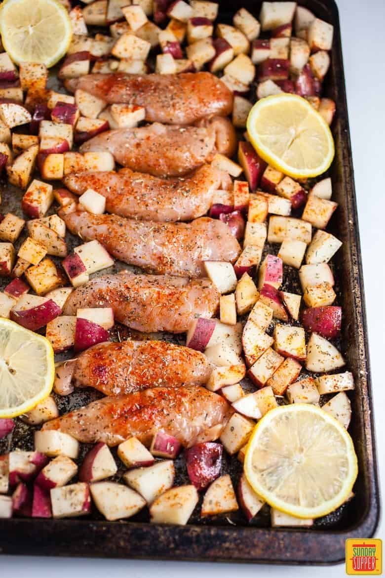 Sheet Pan Greek Chicken and Potatoes on the sheet pan and ready for the oven