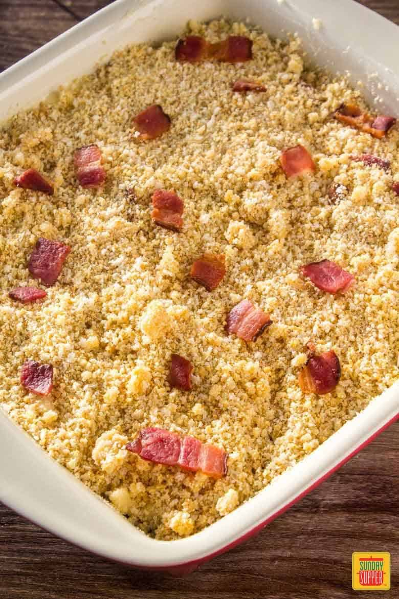 Bacon macaroni and cheese is topped with breadcrumbs and baked in the oven