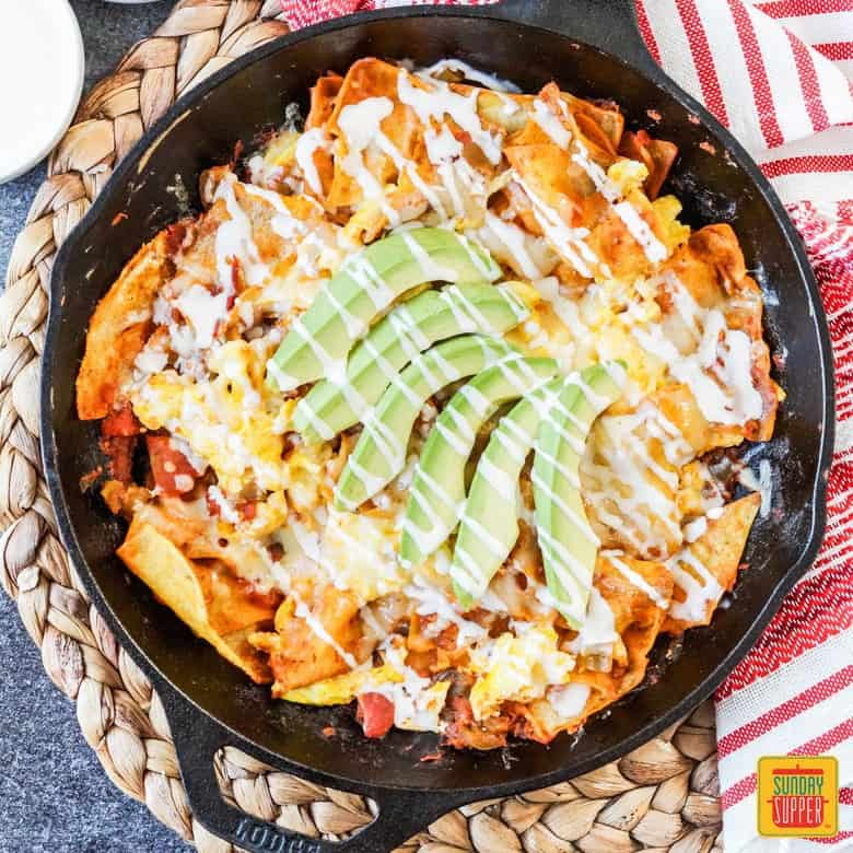 A skillet with Chilaquiles Rojos