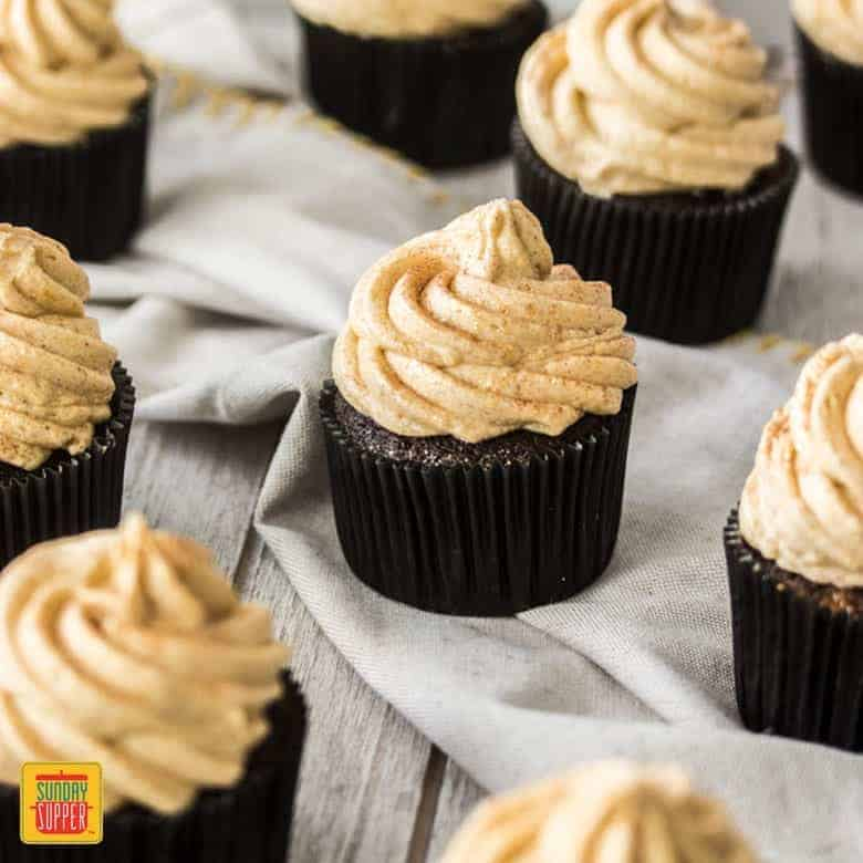 Rows of chocolate pumpkin cupcakes ready to enjoy