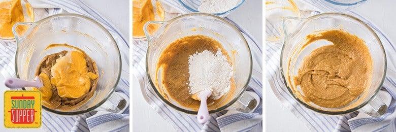 Adding pumpkin puree and flour mixture to batter for pumpkin cupcakes