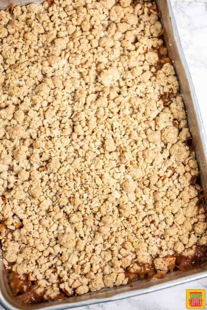 Buttery, delicious baked cinnamon apples apple crisp with streusel topping, ready to serve!