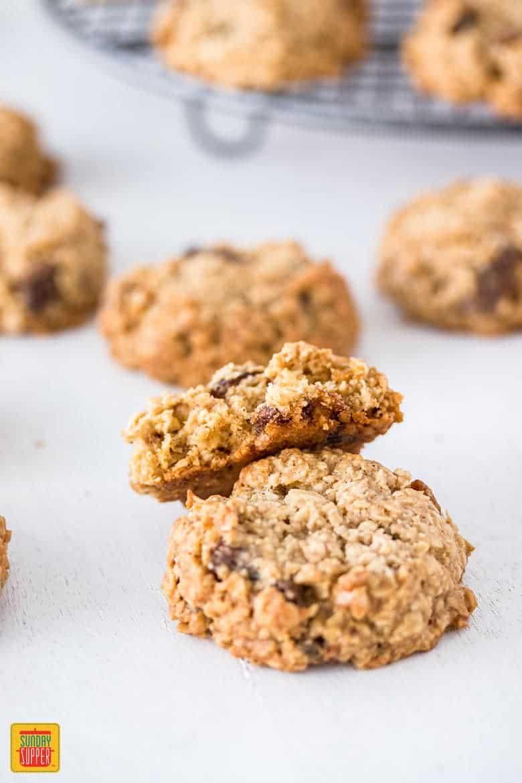 two gluten free oatmeal raisin cookies in focus