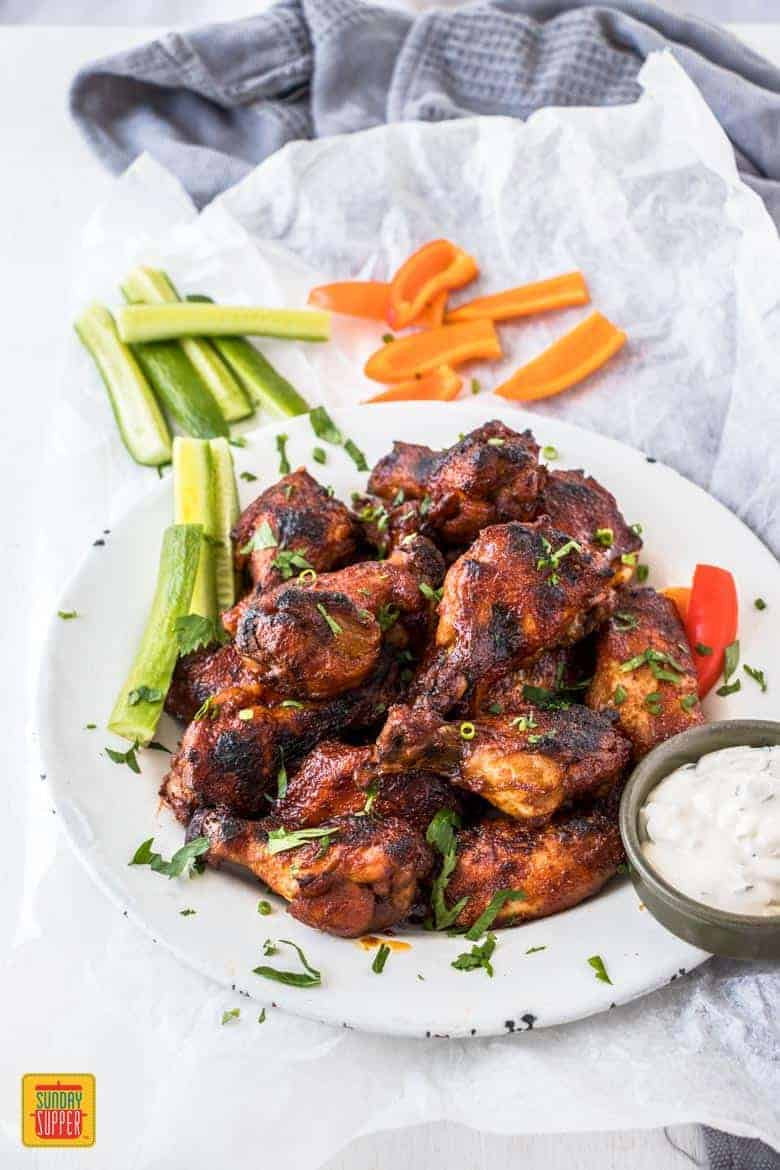 Slow Cooker Wings on a serving plate with a side of vegetables ready to eat