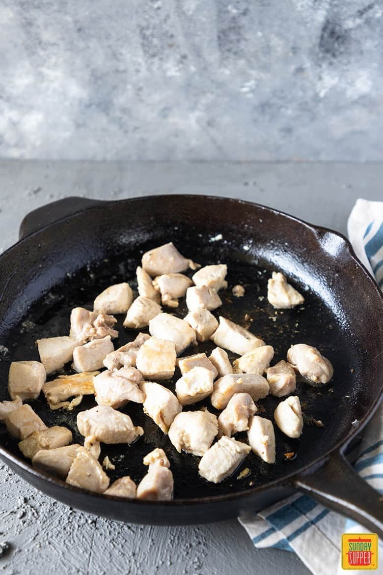 cooked chicken in skillet for Fettuccine Alfredo with chicken