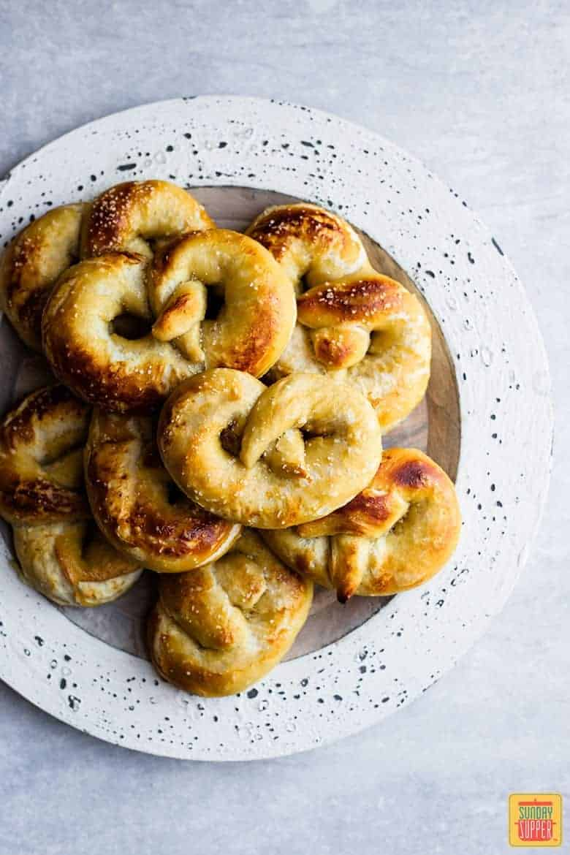 Soft Pretzel Recipe: a white plate of fresh homemade soft pretzels