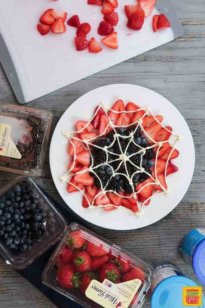 piping the web for spider-man web berry dessert