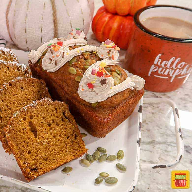 Starbucks pumpkin bread mini loaf on a white platter with pumpkin seeds