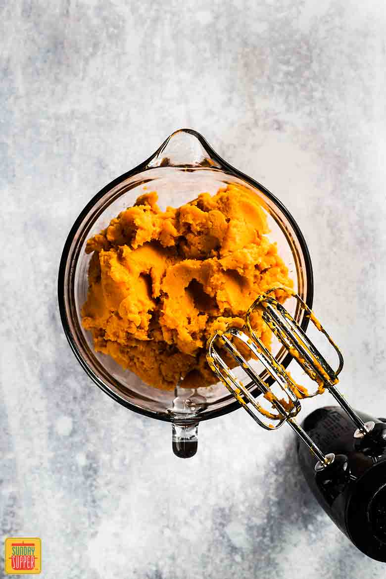 beating the sweet potatoes for Southern sweet potato casserole