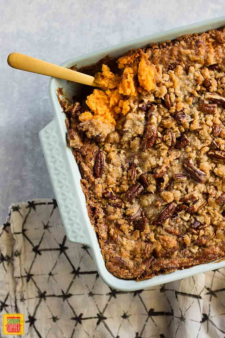 Southern Sweet Potato Casserole in a casserole dish with a serving spoon