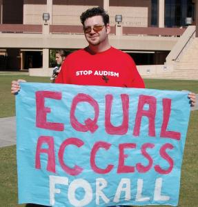 A student holds a sign during the demonstration to end audism.