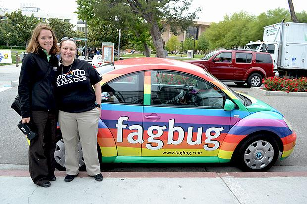 Erin Davies, Fagbug owner and LGBTQ activist, and Sarina Loeb, USU Pride Center and LGBTQ Initiatives Coordinator and organizer of the Fagbug event, stand beside the Fagbug, which has over traveled 250,000 miles across the U.S. to bring about awareness on LGBTQ issues. Photo Credit: John Saringo-Rodriguez / Daily Sundial
