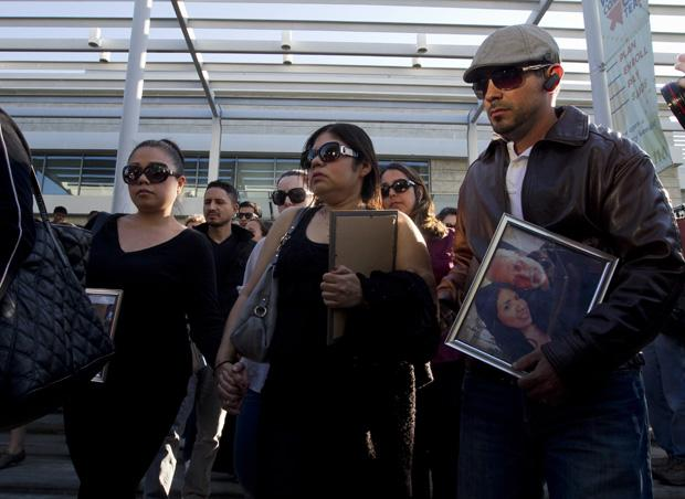 Family members mourn the loss of 26-year old Marcela Franco and her father Carlos Franco at a memorial for the victims of the Santa Monica shooting. They were gunned down in their car by John Zawahri last Friday. Marcella died at the hospital of her injuries.