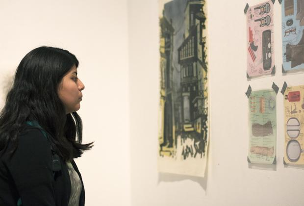 "Janet Solval, 22, senior art major, viewed the different types of art during the CSUN Painting Guild's ""Meet the Guild"" gallery show at the West Gallery room on Wednesday. Solval said she was interested to see the contrast between the abstract and literal paintings at the show. Photo credit: Trevor Stamp / Daily Sundial"