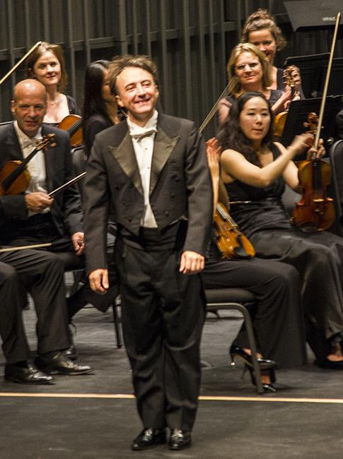 Pianist, Jean-Efflam Bavouzet takes a bow after the London Philharmonic Choir performance at the California State University, Northirdge Valley Performing Arts Center in Northridge, Calif. on Friday, Oct. 10. Photo Credit: Jessica Boyer/ Contributor