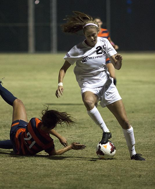 Freshman Kiley Norkus was still standing after jostiling for the ball against Cal State Fullerton's Kaycee Hoove during the Matadors' match on Oct. 19, 2014. The Matadors were unable to keep up their win streak in the Big West Conference, losing to the Titans 1-0. Photo Credit: Trevor Stamp/ Senior Photographer