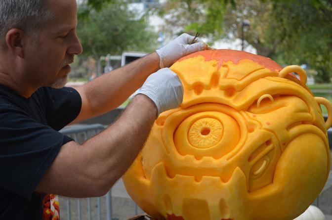 John Niell shows off his pumpkin carving skills on CSUN campus.