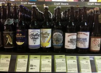Display of eight beers in a Beer and Wine store.