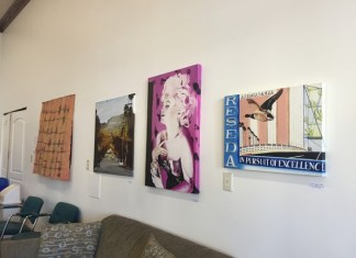An art tour with three forms of art pinned up one wall. FIrst: a street perspective, a portrait of Marilyn Monroe and a scene of bridge and street with bird soaring over