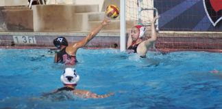 Water polo athlete attempts goal against CSUN student water polo athlete