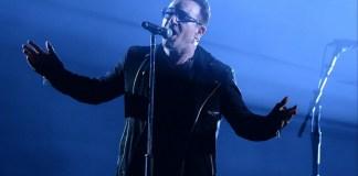 U2 frontman, Bono, sings on stage
