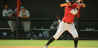 Baseball athlete bats at home base