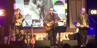 Larkin Poe and Elvis Costello perform on stage