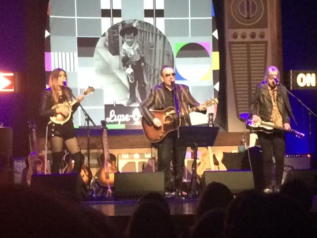 Larkin Poe and Elvis Costello perform on stage