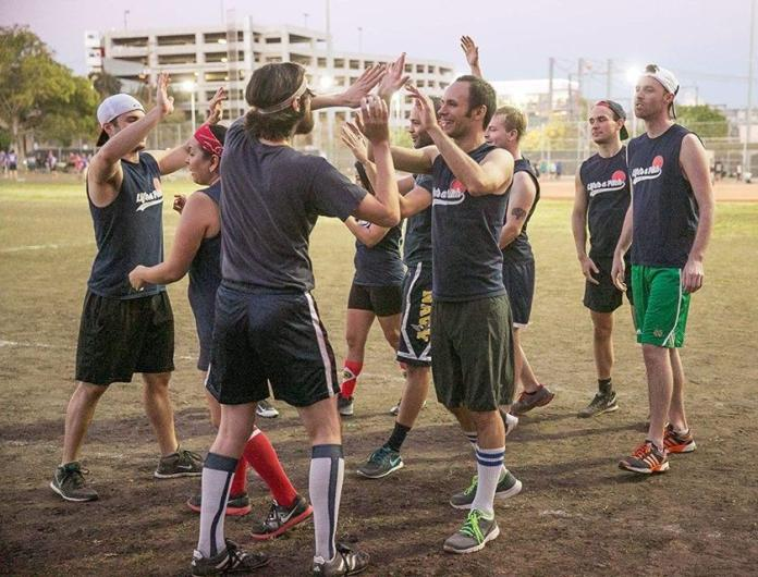Team high fives each other