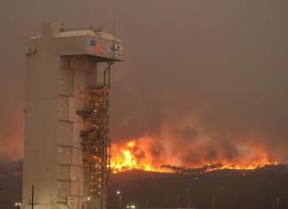 fire shown behind air force base