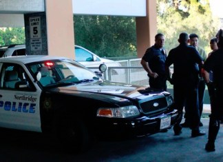 Police surround man in CSUN parking structure