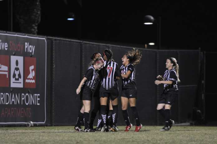 Matador soccer team shown on field celebrating a goal
