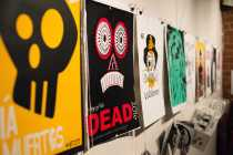 Photo shows illustrated posters for day of the dead
