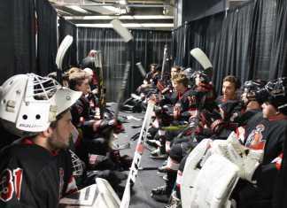 matador hockey team sits together before game