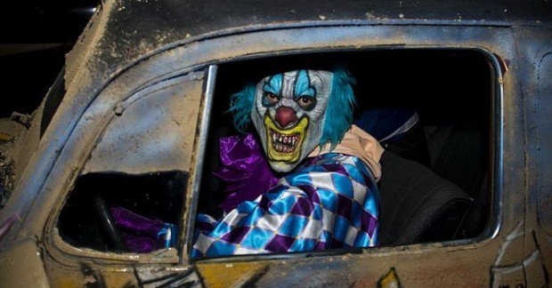 Creepy clown pictured inside beat-up car