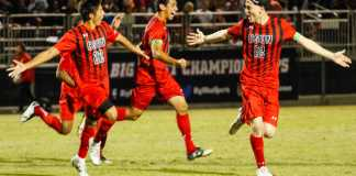 CSUN soccer players run across the field
