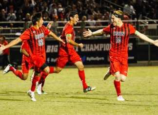 CSUN soccer players run across the field