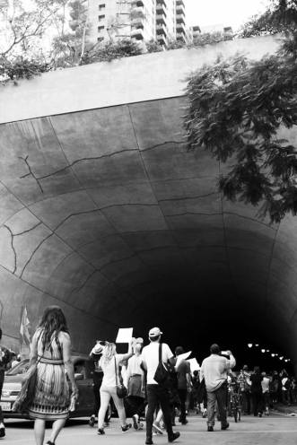 Protesters march through tunnel