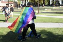 Student shown wearing rainbow flag