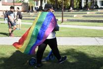 Student shown wearing rainbow flag