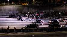 Photo shows police trying to stop protests on the freeway