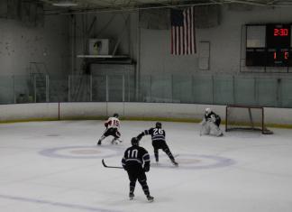 CSUN hockey player shoots for a goal