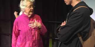 Peggy McIntosh speaks with CSUN student