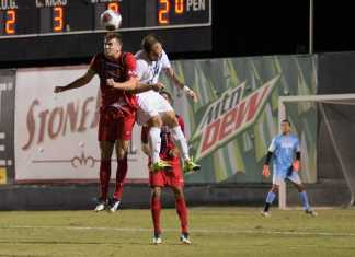 CSUN and CSUF player aim for a header