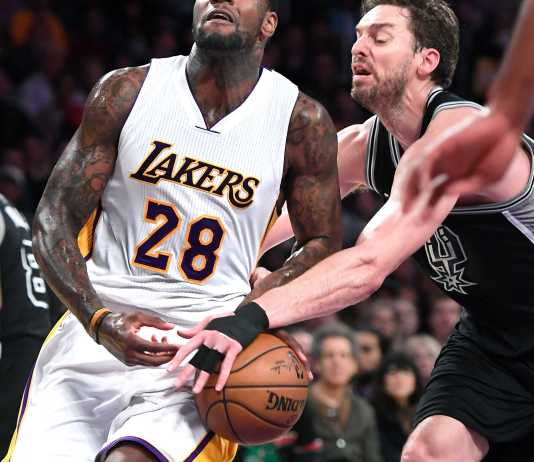 Member of the opposing team steals the ball form Laker's player