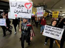 People protest the travel ban