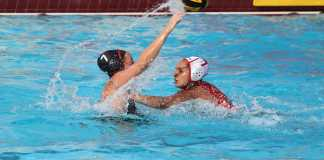 Water polo player throws the ball