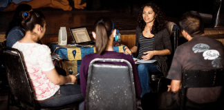 Jasmin Lopez teaches radio reporting to several students
